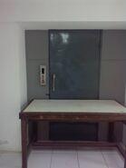 Derelict manual door elevator