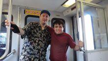 Alex (right) is a huge fan of transit as well