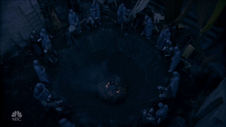 The Wizard has the High Council chained to the pit holding the young witch
