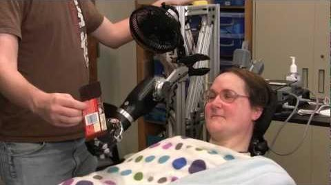One Giant Bite Woman with Quadriplegia Feeds Herself Chocolate Using Mind-Controlled Robot Arm