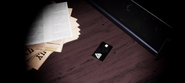 The black keycard required to open the extras