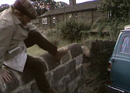 Emmie amos climbs over wall 1977