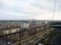 View of Chernobyl taken from Pripyat.png