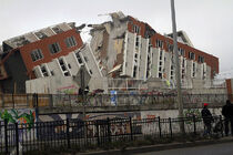 800px-2010 Chile earthquake - Building destroyed in Concepción