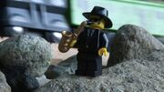 Samson, BoCo, and the Man in the Hills The Saxophone Player