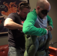 Dragon Radic helping EpicLLOYD into the TMNT suit