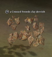 A Crossed Swords clay dervish