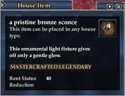 A pristine bronze sconce