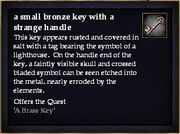A small bronze key with a strange handle
