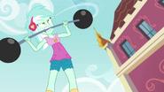 Lyra biting a barbell EG3
