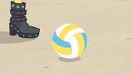 Volleyball rolls next to Sunset's feet EGFF