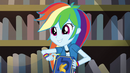 Rainbow Dash holding a yearbook EG3