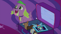 Spike sitting next to Sci-Twi's suitcase EG4.png