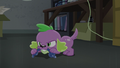 Spike chews on a chew toy EG3.png