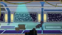 Cloaked figure runs through a sci-fi movie set EGS2