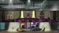 Cloaked figure runs through a racing movie set EGS2