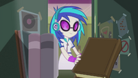 DJ Pon-3 taking book from locker EG2