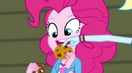 Rainbow picks chocolate chip off of Pinkie's cookie EG2
