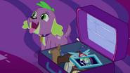 Spike sitting next to Twilight's suitcase EG4