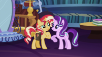Starlight Glimmer nudges Sunset with her elbow EGS3