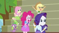 Twilight's friends and Spike cheering