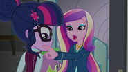 Dean Cadance picks a dog hair from Sci-Twi's shirt EG3