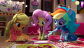 AJ, Fluttershy, and Rainbow play a board game EGM4.png