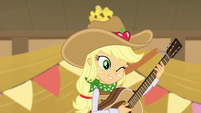 Applejack winking and holding a guitar EGDS25