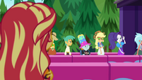 Applejack and Rarity entering the festival EGSBP