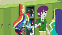 Rainbow putting a ball in her locker EGDS42