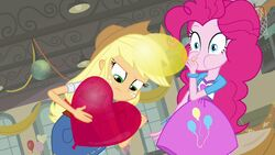 Applejack draws on a balloon