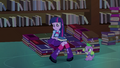 Twilight sits on bed of books EG.png