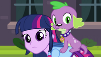 Twilight and Spike looking at a student EG