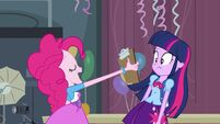 Pinkie Pie holding up a clipboard