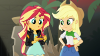 Sunset Shimmer holding a candy wrapper EGS2