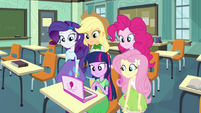 Twilight and friends in front of a laptop EG