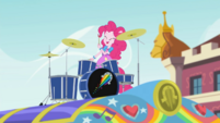 Pinkie Pie plays drums on top of the tour bus SS13