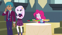 Pinkie covertly seizes the snack table trays EG3
