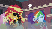 Equestria Girls shielding themselves from the wreckage EG3