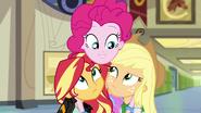 Pinkie Pie with arms around Sunset and Applejack EG3