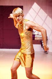 Sam in gold shorts