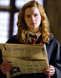 Hermione Granger reading The Daily Prophet