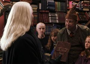 Lucius enfrentándose a Arthur