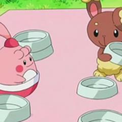 Happiny y Buneary sirviendo los platos.
