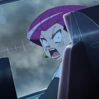 Jessie mirando hacia la parte de atrás del robot, sorprendida por el poder de Zapdos...