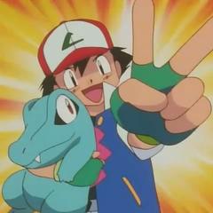 Ash cuando captura a Totodile, después de vencer a Misty.
