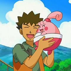 Brock abrazando a Happiny.