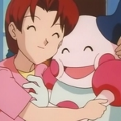 Delia abrazando a Mr. Mime.