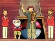 EP408 Tyson con el trofeo de la Liga Pokémon