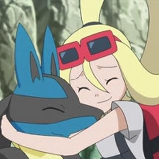 Korrina/Corelia abrazando a Lucario.